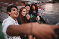 Young people making selfie on a jetty - PhotoDune Item for Sale