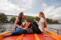 Teenage friends relaxing on pedal boat - PhotoDune Item for Sale