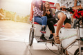 Young women sitting on tricycle and posing for selfie - PhotoDune Item for Sale