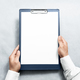 Hand holding blank clipboard with white a4 paper design mockup. - PhotoDune Item for Sale