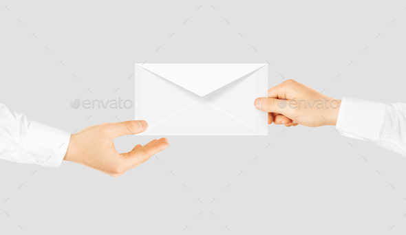 White blank envelope giving hand. Message send presentation. - Stock Photo - Images