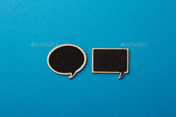 square and round charcoal speech bubbles on blue - Stock Photo - Images