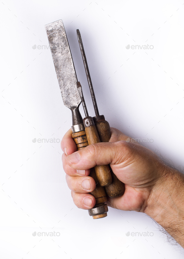 Strong hand holding tools with wooden handles on white backgroun - Stock Photo - Images