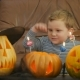 Boy Blowsscary Candles On Pumpkin During Halloween - VideoHive Item for Sale