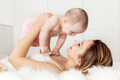 Mother with her newborn baby daughter. Candid emotions of maternity love. - PhotoDune Item for Sale