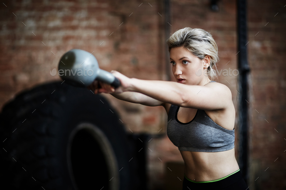 Exercising in gym - Stock Photo - Images