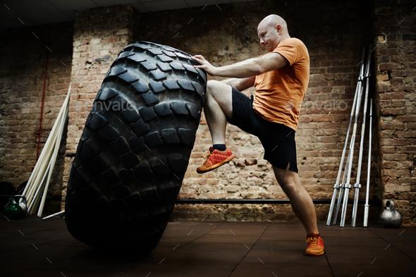 Pushing tire - Stock Photo - Images