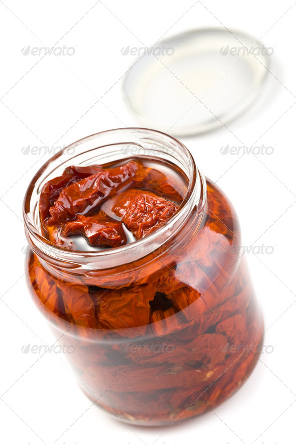 dried tomatoes in glass jar - Stock Photo - Images