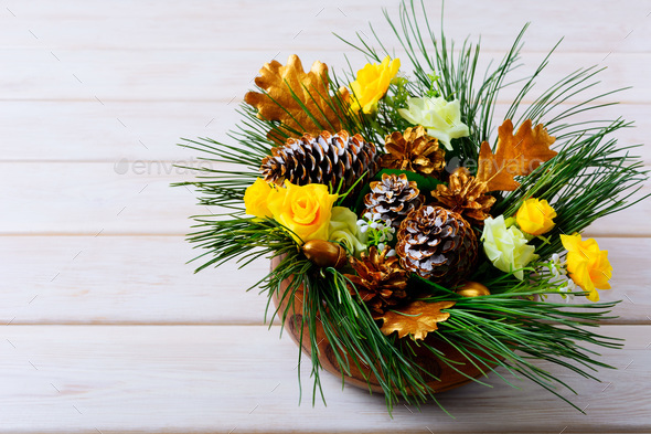 Christmas table decoration with pine branches and golden cones - Stock Photo - Images