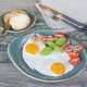 Fried eggs,  bacon, tomato, toast and butter - PhotoDune Item for Sale