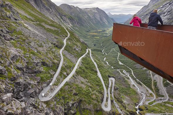 Norwegian mountain road. Trollstigen. Stigfossen waterfall. Norway tourist viewpoint. Horizontal - Stock Photo - Images