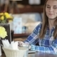 Young Pretty Woman With Laptop Gets Coffee From Waiter In Cafe - VideoHive Item for Sale