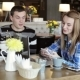 Boy And Girl In Cafe. People Use Laptop And Smartphones, Talk And Drink Coffee - VideoHive Item for Sale