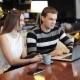 Young Caucasian Couple With Modern Laptop In Cafe - VideoHive Item for Sale