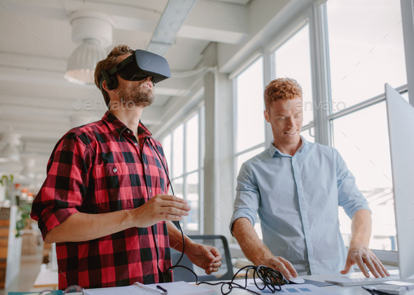 Young developers improving virtual reality glasses - Stock Photo - Images