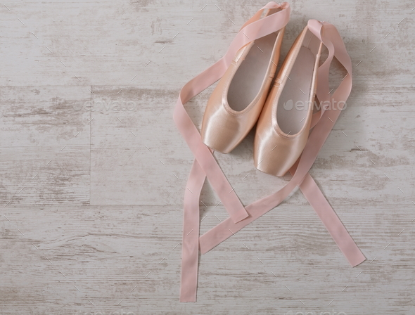 Pink ballet pointe shoes on white wood background - Stock Photo - Images