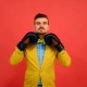 Guy In Yellow Jacket And Gloves Corrects Tie - VideoHive Item for Sale