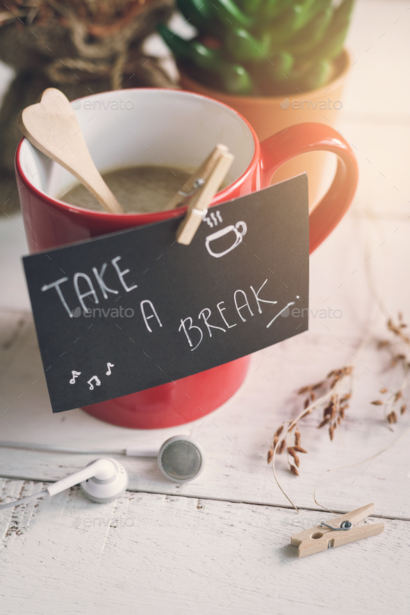 Red cup of coffee with take a break note - Stock Photo - Images