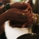 Woman Puts Green Grains In Bride's Palms - VideoHive Item for Sale