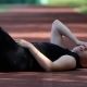 Tired Girl Resting After Jogging On The Floor At The Stadium - VideoHive Item for Sale