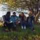 Four Multiracial Friends Sitting At Rural Area. - VideoHive Item for Sale