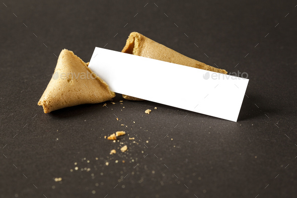 a fortune cookie with a blank paper for your message - Stock Photo - Images