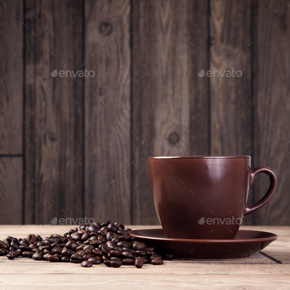 Warm Cup Of Coffee On Brown Background - Stock Photo - Images