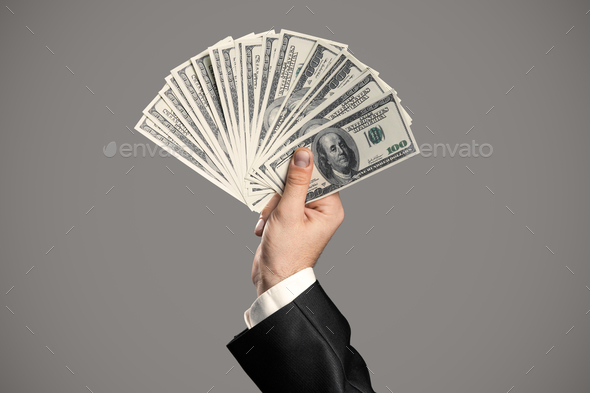 Business Man's Hand To Holding Money. Handful Of Dollars. - Stock Photo - Images