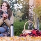 Young Beautiful Woman Sitting On Picnic Drinking Hot Tea From a Thermos In Autumn Park. Girl Sitting - VideoHive Item for Sale