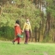 Guy Picks Up Girl On Hands And Circling Her In Woods - VideoHive Item for Sale