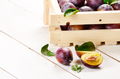 Wooden crate with plums closeup - PhotoDune Item for Sale