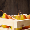Wooden crate with pears on white table - PhotoDune Item for Sale