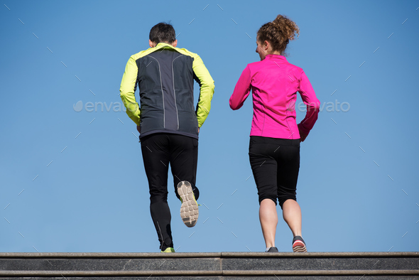 young  couple jogging on steps - Stock Photo - Images