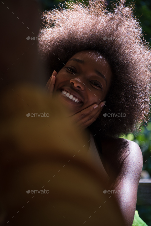 Close up portrait of a beautiful young african american woman sm - Stock Photo - Images