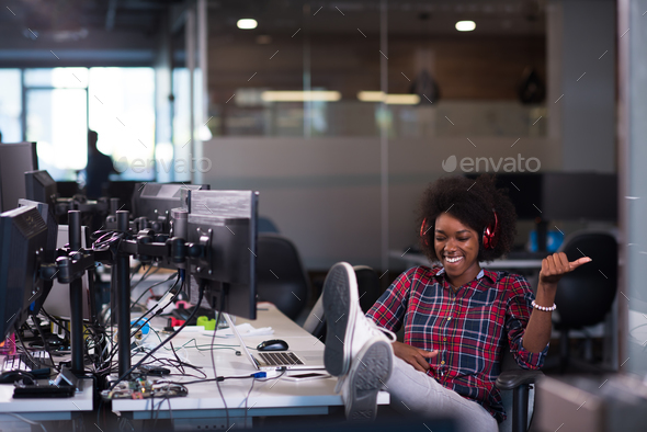 portrait of a young successful African-American woman in modern - Stock Photo - Images