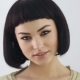 Smiling Girl With Cleopatra's Make-up And Haircut Posing In Studio - VideoHive Item for Sale