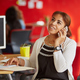 Confident female designer talking on a mobile phone in red creative office space - PhotoDune Item for Sale