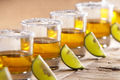 tequila shots in a row with lime slice and salt
