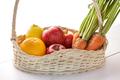fresh lemons, apples, and carrots in basket