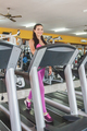 beautiful sporty woman smiling on treadmill