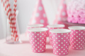 party pink paper glass on a table - PhotoDune Item for Sale