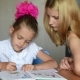 Grader In a Good Mood Makes School Lessons With Her Mother