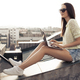 Side View Of A Young Woman Using Laptop At House Roof - PhotoDune Item for Sale