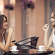 Smiling Young Women Drinking Coffee And Talking Outdoor - PhotoDune Item for Sale