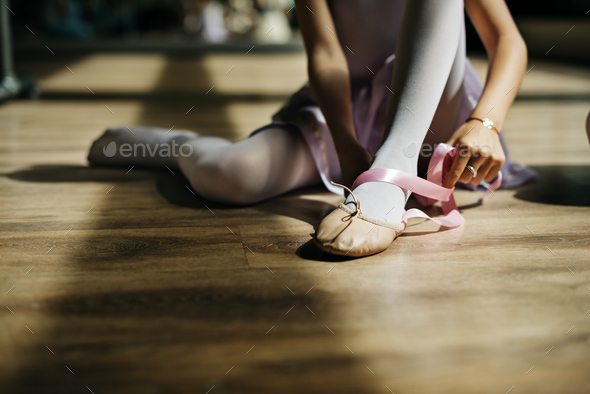 Ballerina Girl Tie Shoes Concept - Stock Photo - Images
