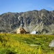 Sunny mountain alpine landscape with camping tents - PhotoDune Item for Sale