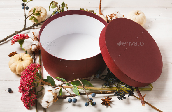 Empty present box with autumn decorations flowers background - Stock Photo - Images