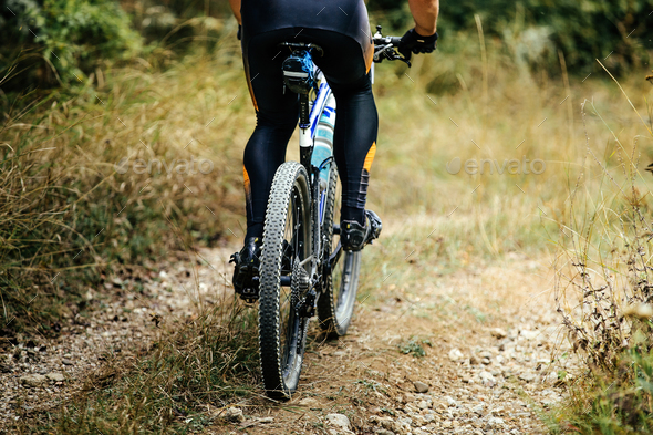 closeup of rear wheel sports mountain bike - Stock Photo - Images