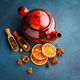Teapot with dry tea over the blue background. - PhotoDune Item for Sale