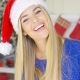 Adorable Blond Girl In Christmas Hat In Her Home - VideoHive Item for Sale